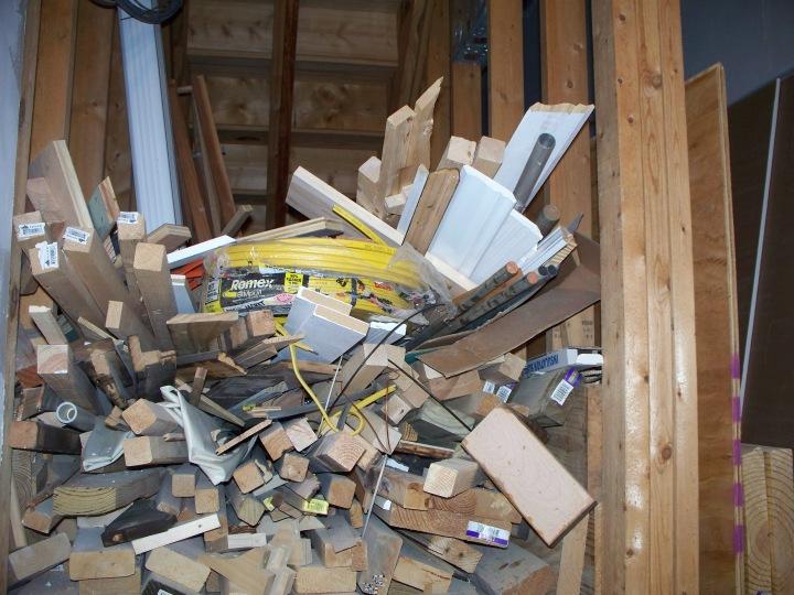 Lumber & stuff under stairs