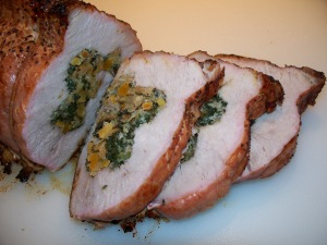 Grilled pork loin stuffed with spinach, apricots, and pistachio nuts.