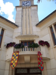 Former city hall with quilts