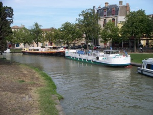The green and white La Naïade moored in Carcassonne