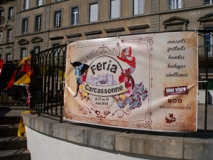 La Feria poster on the stage at Place Carnot