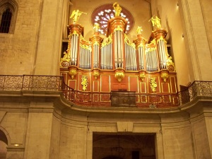 Gold leaf shimmering on the pipe organ