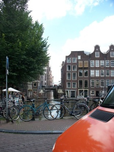 Amsterdam: bikes, canals, tall narrow buildings