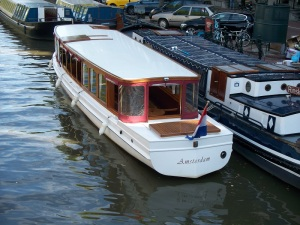A narrow tour boat