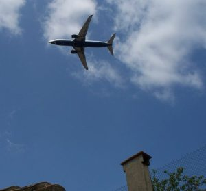Plane over rooftops