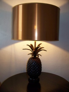 A copper shaded lamp