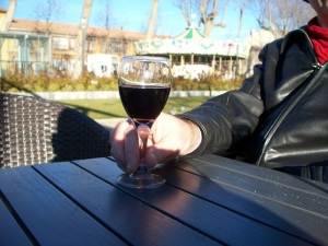 A glass of wine at an outdoor café