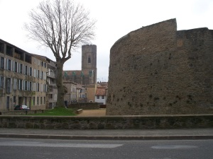 A city wall corner with St. Vincent's tower behind