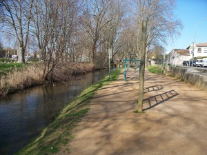 Mill stream walking path with exercise equipment